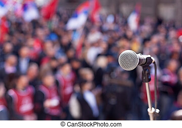 Protest. Public demonstration. - Microphone in focus against...