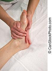 foot sole massage - a closeup of a foot of a natural mature...