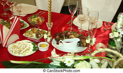 Celebratory table - Moving camera Beautifully laid a festive...