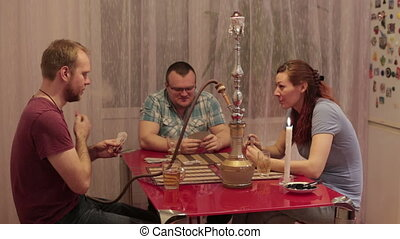 Family hookah smoking and talking - Two men and a woman...