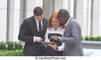 Multi ethnic business eteam at company office building, work...