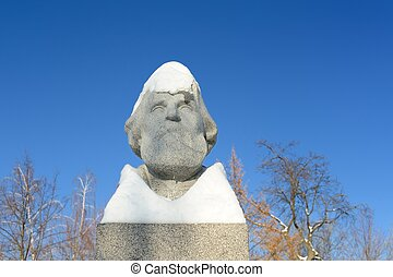 Ivan Turgenevs monument in Orel, Russia under snow copyspace...