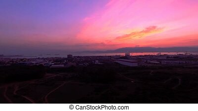 4K Aerial, Sunset and night flight near Gibraltar, Spain -...