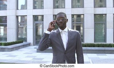 young African American business man using a mobile phone - Black people