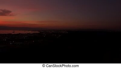 4K Aerial, Sunset and night flight - Night flight near...