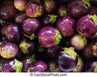 Fresh Brinjal at Market - Close-up view group of fresh...