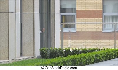 smiling business woman on the phone at modern building, slow...