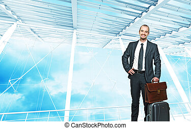 businessman travel - young smiling businessman with bag and...