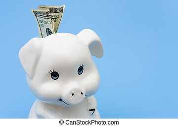 Adding to your Savings - A piggy bank with cash in it on a...