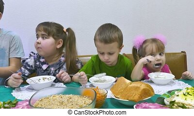 Children eat breakfast a family birthday celebration...