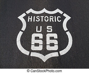 Historic US 66 - Historic US Route 66 pavement road sign in...