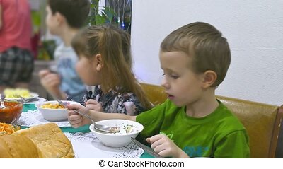 Children eat breakfast birthday family christmas boy and...