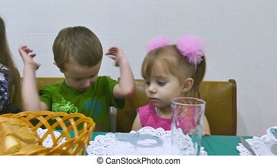 Children eat family boy and girl breakfast birthday...