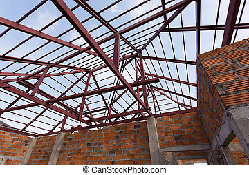 structural steel beam on roof and brick wall of building...