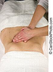 abdominal pressure massage - a closeup of a natural mature...
