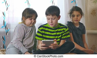 children play in tablet girls and one boy - children play in...