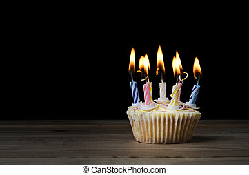Birthday Cupcake with Lit Candles on Black