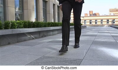 businessman out of the building, slow motion