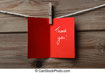 Red Thank You Card Pegged to String on Wood Background - A...