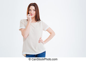 Thoughtful young woman standing and thinking