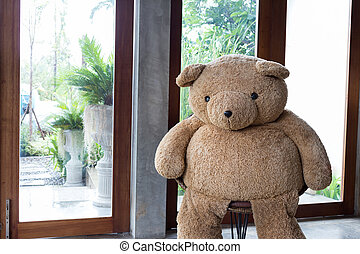 interior home decoration, big bear sitting on chair