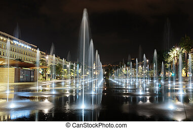 Fountain in the square Masena in Nice - NICE, FRANCE -...