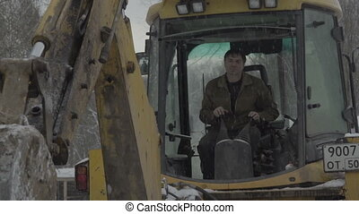 the man who controls the excavator drips hd