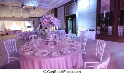Banquet hall is illuminated with colored lights