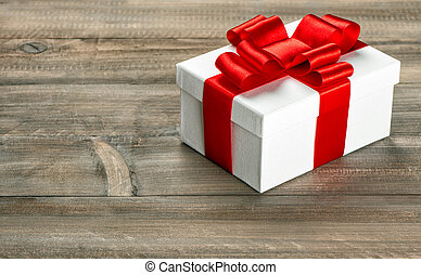 Gift box with red ribbon bow Holidays decoration - Gift box...