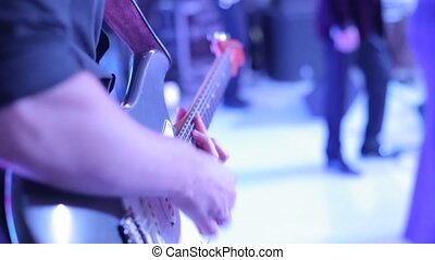 The musician plays the electric guitar at the concert
