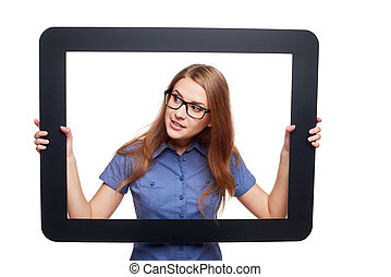 Surprised female peeping out of tablet frame - Woman peeping...