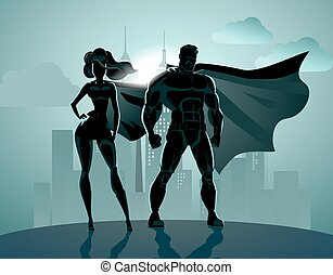 Superhero Couple: Male and female superheroes, posing in front of a light
