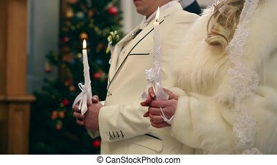 two candles and veil - wedding ceremony in church Ukraine