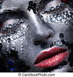 Girl with glitter and rhinestones on her face. Beauty close-up.
