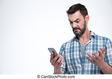 Angry man holding smartphone isolated on a white background