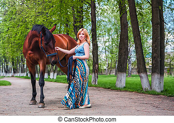 Young blond with a beautiful horse
