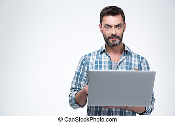 Serious man using laptop computer isolated on a white...