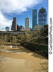 Vertical of a Houston skyline with bayou in front - A...