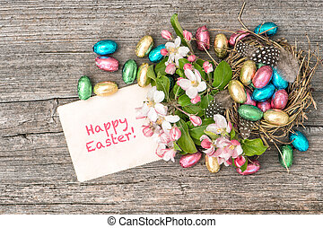 Chocolate easter eggs and apple tree blossoms. Spring...