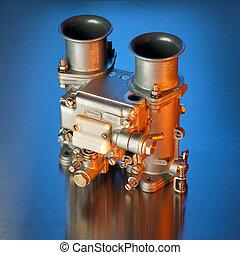 Italian automobile carburetor - Carburetor in orange and...