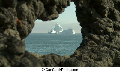 Disko Island Greenland - Looking out on a iceberg through a...
