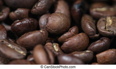 Roasted Coffee Beans on a Table Rotating Close-up