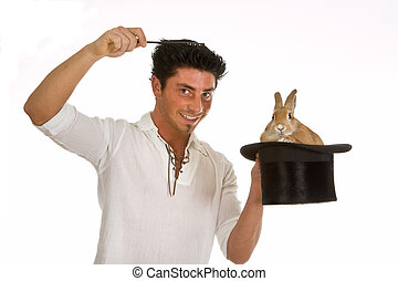 Rabbit magic - Young man holding a magic wand above a rabbit...
