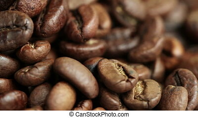 Roasted Coffee Beans on a Table Rotating. Close-up