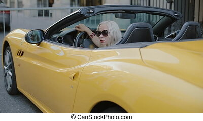 Blonde behind the wheel of the cabriolet - Attractive blonde...
