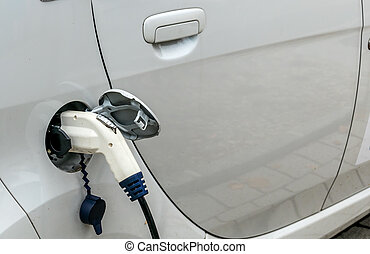 electric car at charging station symbol of ecology,...