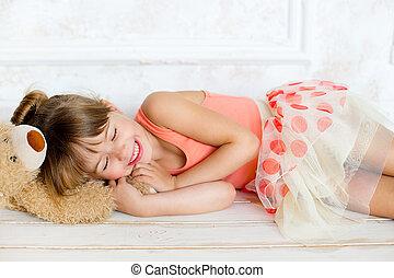 the little ballerina sleeps on a teddy bear - the little...