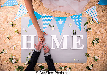 Wedding ring and home word - Putting wedding ring and white...