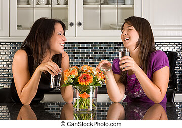 Drinking water in the kitchen - Two friends drinking water...