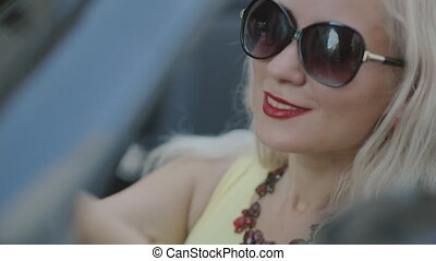 Woman with red lipstick sitting in the car